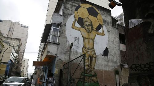 A graffiti referring to the 2014 World Cup is seen in Rio de Janeiro